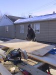 Bob weathers the brisk Chicago area January to cut roof decking for the carport.