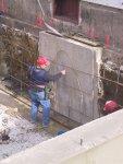 Jim Voitman exhibits his artistic talent.  Stick to concrete, Jim!