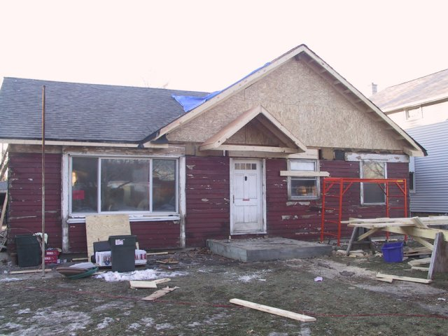 As they finish the facade, I notice a teensy little problem... can you see it?