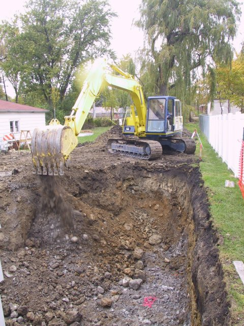 In comes the heavy equipment to make quick work out of creating this basement hole!