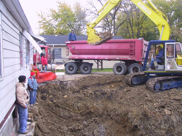I never thought I'd see the day when a semi backed into my driveway!  12,000 cubic feet of dirt was removed to make way for the basement and foundation under the addition.