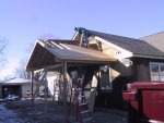 While I wasn't looking, a carport got put up!
