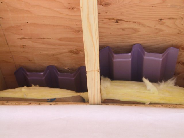 Time for insulation.  Here we see the condensate barrier for the vaulted ceilings.