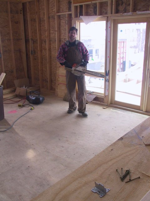 """After having switched HVAC contractors, we get one with a chain saw! Here, he's cutting holes in the floor for ducting """"registers"""" or """"diverters."""""""