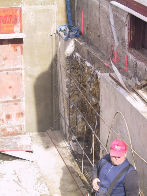 """Prior to pouring the """"dead wall,"""" more dowling and reinforcing bar is added.  Note the keyway cut into the side wall... the new pour will interlock into that and prevent subsequent movement."""