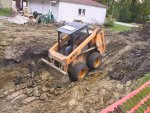 """Bobcat"" gets rear wheels in the air while doing the initial digs for the basement under the addition"