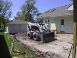 """The """"concrete guys"""" are back on the job, destroying what was left of the old black-top driveway, preparing for the small patio and new concrete drive."""