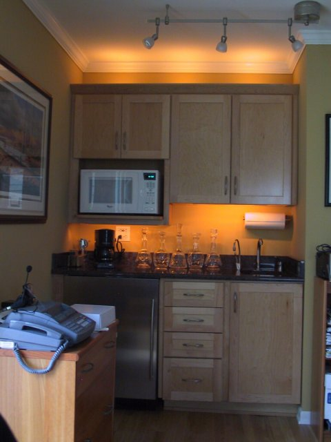 This is a less-than-sharp image of the wet bar in the home office, exhibiting the indirect and task lighting that I installed after construction.