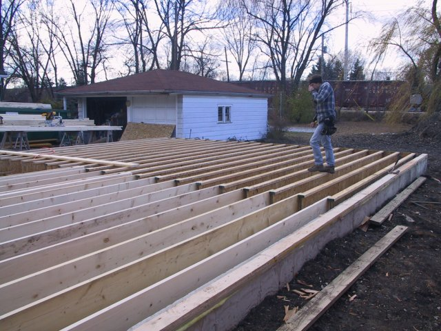 Once the plate and load bearing structures are in place in the basement, the floor joists get installed: 14 inch tall laminate beams and 2x10s.