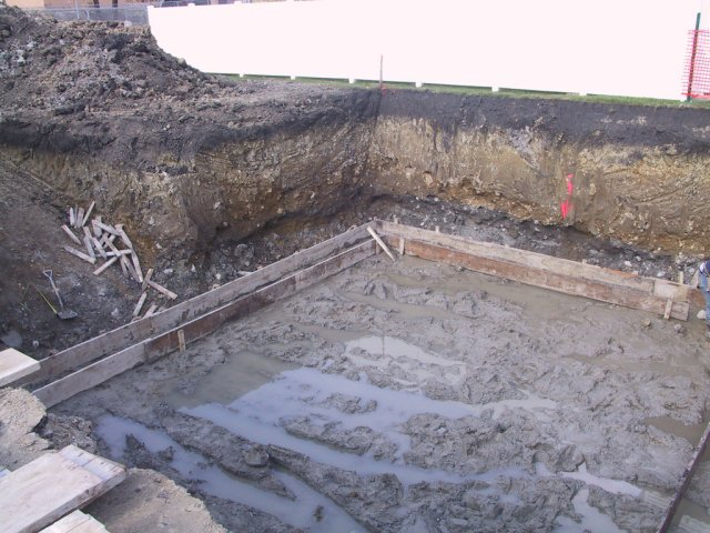 The footing framing begins.  Clearly, the planned sump pumps will come in handy.