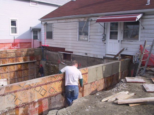 "Before the ""dead wall"" is formed up and poured, the three exterior walls are poured, and the forms removed."