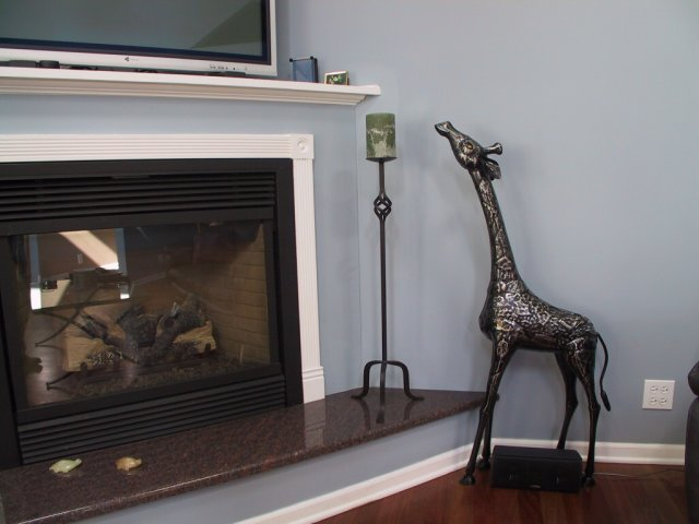 I found this steel giraffe sculpture that seemed perfect next to the fireplce.  He's watching TV.