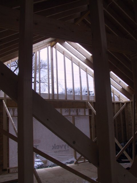 Interior framing, with a view of the peak of the great room, which will have a vaulted ceiling.