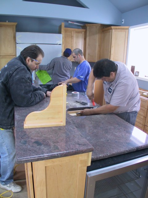 """The kitchen counters are all being done in """"Paradiso.""""  This granite, from India, has the same basic colors as Dakota Mahogany, but in a different mix and with finer grain texture and more """"movement."""""""