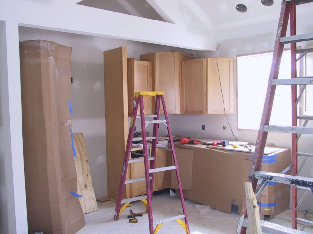 And the kitchen cabinets continue past the sink and garden window wrapping into the alcove.