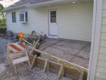 The corner patio between the South and West entrances off the driveway is formed up.