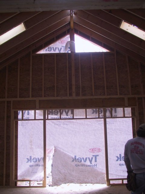 Here we see the French doors and side-lights being framed in, along with two skylights and two peak windows.