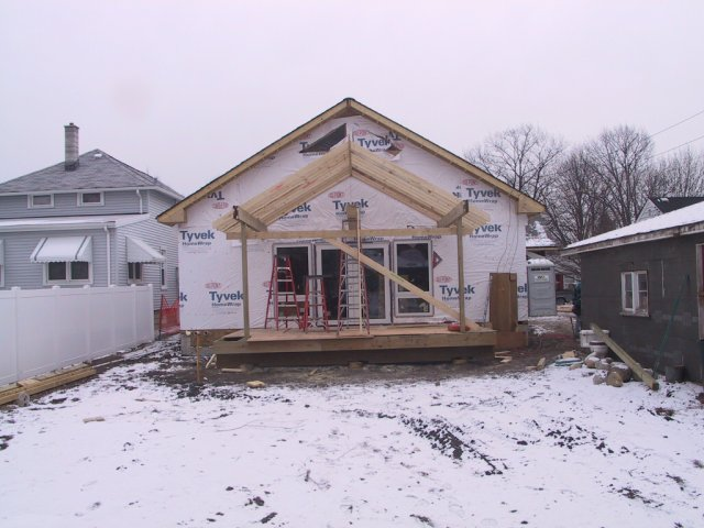 "And ""out back"" a deck and gable get built."