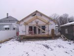 """And """"out back"""" a deck and gable get built."""