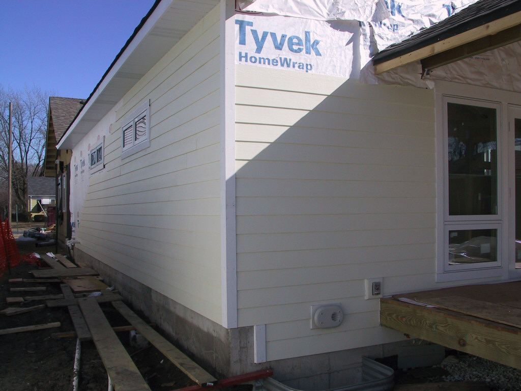 Siding now wraps the back (West) and North sides of the house.