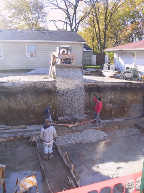 """I call this """"stone fall""""... fast way to get stone safely into the hole.  The space under the slab can hold about 5,000 gallons of water!"""