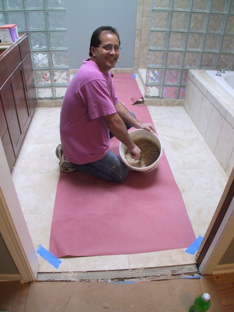 "Here ""the tile guy"" mixes some sanded grout for use in the master bath."