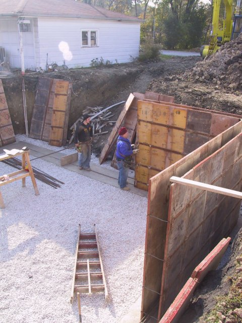 """The concrete forms for the basement walls go up.  These will be 10"""" thick, 10' tall walls."""