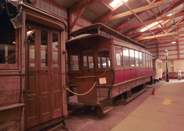 """Before electrified street railways, Chicago had cable cars much like SanFrancisco.  This is a cable car trailer from the Chicago line.  Chicago's famous """"loop"""" downtown area was named for the cable that pulled these cars around. Car indoors at one of the Illinois Railway Museum protective display barns.Kodacolor 35mm film, available light, 21mm wide-angle lens."""