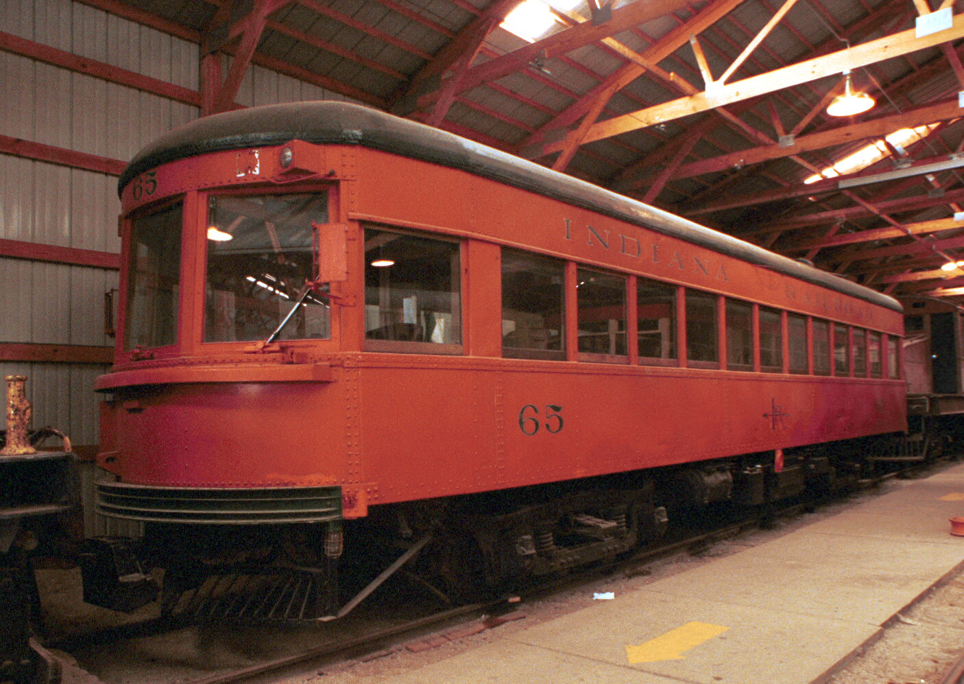 Indiana Railway #65 was the car that started the Illinois Railway Museum. Image taken in one of the IRM's display barns with available light.Kodacolor 35mm film (probably 400ASA), 21mm lens.