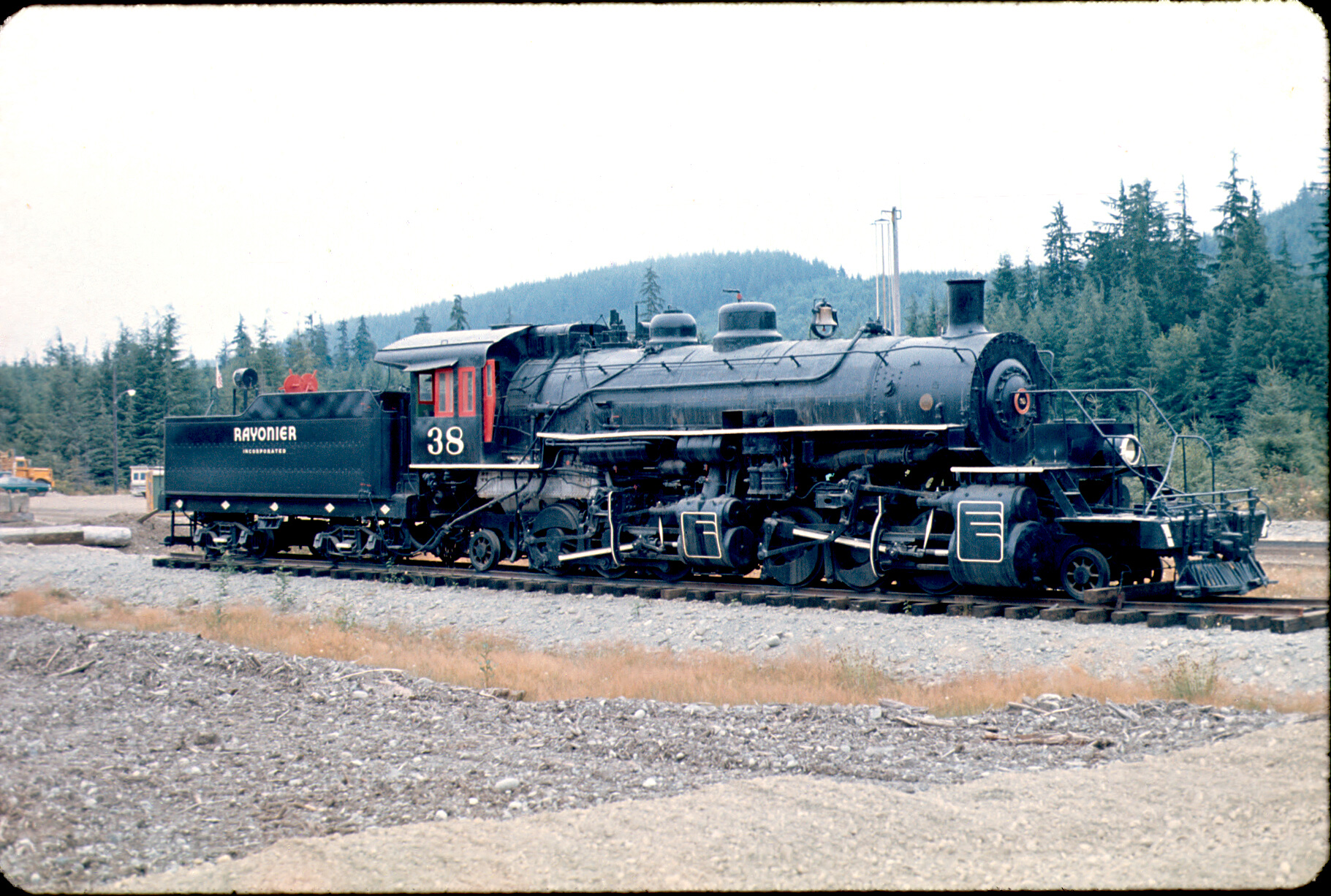"3/4 view of Rayonier 38, a small Baldwin 2-6-6-2 Mallet steam locomotive.35mm slide. Image purchased from a collection found in a ""used goods"" store on Seattle's waterfront in the mid 1990s. No other details available."
