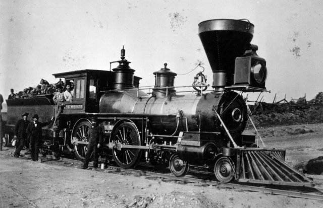 Port Washington, an old 4-4-0 Steam Locomotive from the early days of the Chicago and North Western RR. From a purchased collection, scanned from a 8x10 B&W print, made from a negative that was showing signs of mildew or mold, causing blotches and image deterioration.